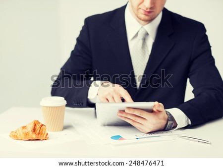 close up of man with tablet pc and cup of coffee - stock photo