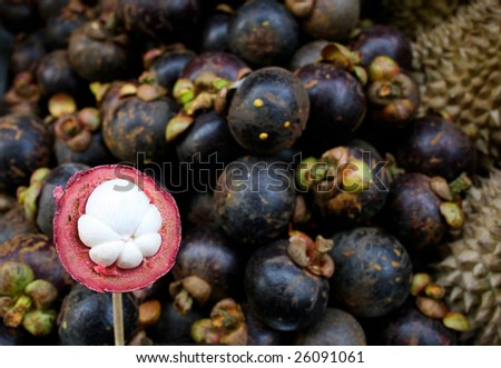 Close-up of mangosteen at a fruit stall. - stock photo