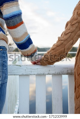 Close up of mans hand holding a hand of a woman - stock photo