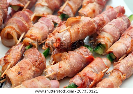 Close up of many Bacon Rolls on plate. - stock photo