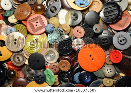 Close-up of many colorful buttons in a collection - stock photo