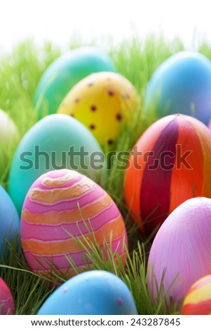 Close Up Of Many Colorful Easter Eggs On Sunny Green Gras For Easter Or Seasons Greetings Eggs In Different Colors Mostly Pink And Blue - stock photo