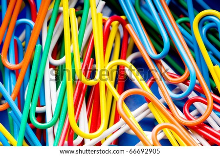 Close up of many colourful paper clips - stock photo