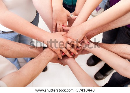 close up of many hands in circle - students connection - stock photo