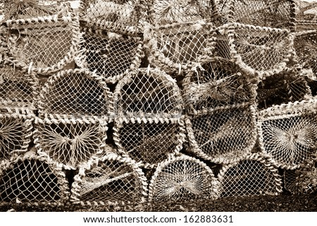Close up of many lobster cages with a vintage process.
