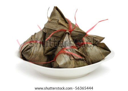 Close up of many rice dumplings on plate over white background. - stock photo