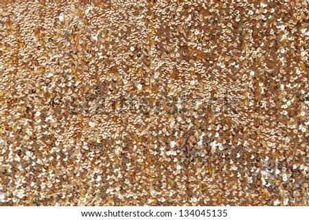 Close up of many shiny gold sequins - stock photo