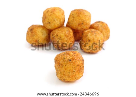 Close up of many snack balls over white background.