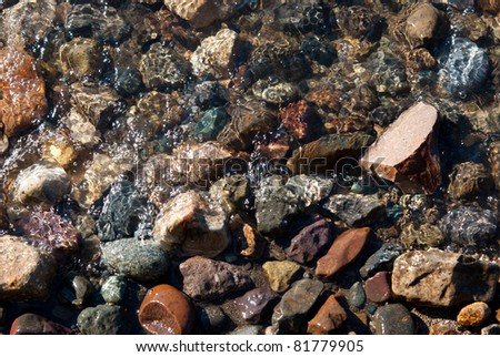 Close up of many volcanic colored stones on Lacar lake in San Martin de los Andes Patagonia Argentina