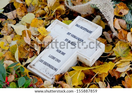 Close up of marble cross with German text - stock photo