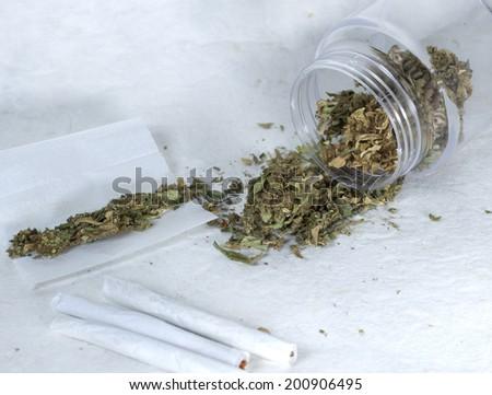 close up of marijuana and cigarettes - stock photo