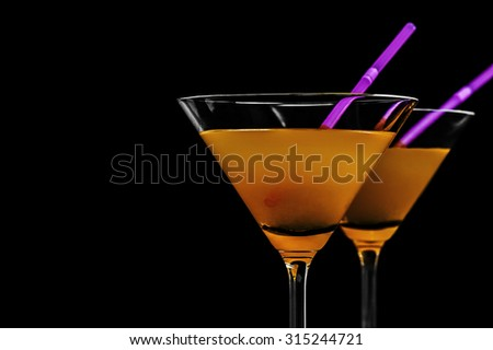 Close-up of martini on a black background