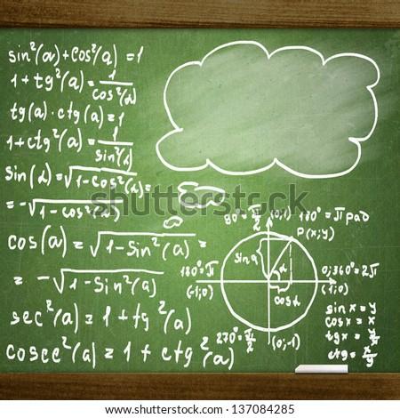 close up of math formulas on a blackboard - stock photo