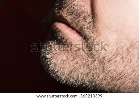 Close-up of mature man, low key - stock photo