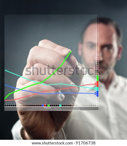 Close-up of mature man writing on virtual screen