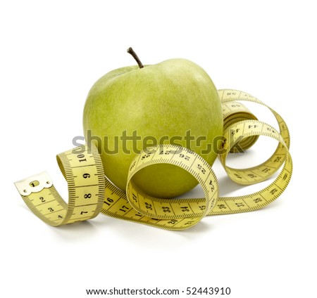 close up of measure tape and green apple on white background with clipping path