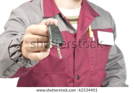 Close-up of mechanic giving a car key. Isolated on white - stock photo