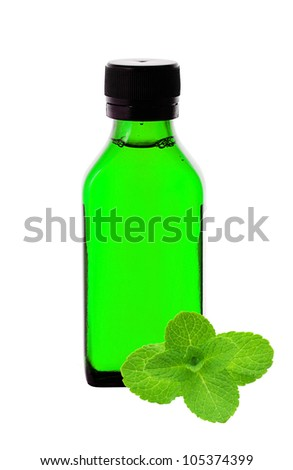 Close up of medicine bottle with green syrup and mint herb isolated on white background - stock photo