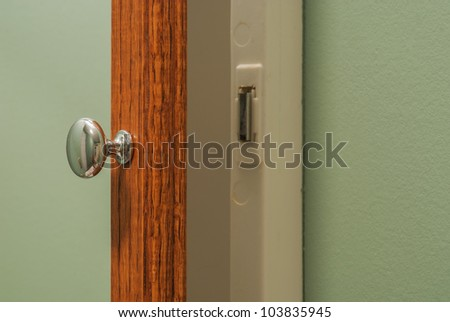 Close-up of medicine cabinet with door slightly open. - stock photo