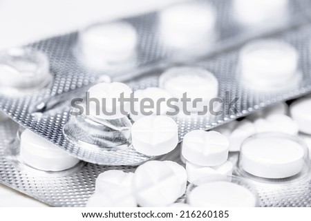 Close up of medicine white tablets in the blister