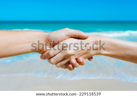Close up of men and women holding hands - stock photo
