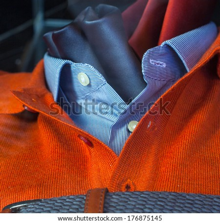 Close up of men's clothes, pullover shirt and necktie - stock photo