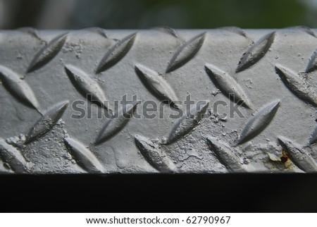 Close up of metal diamond plate texture. - stock photo