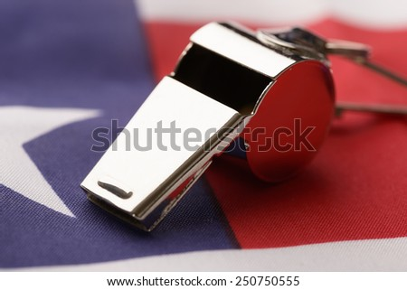 Close-up Of Metal Sport Whistle On American Flag - stock photo