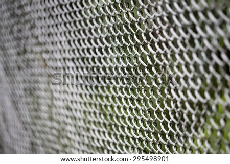 Close up of metal twist fence  - stock photo