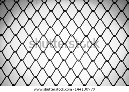 Close up of metal twist fence in black and white tone - stock photo