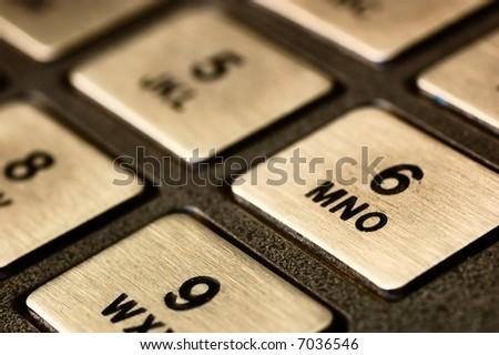 Close-up of metallic keypad of an automated teller machine - stock photo