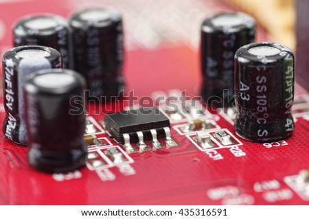 Close up of Microchip, Resistor and Capacitors on printed circuits board - stock photo