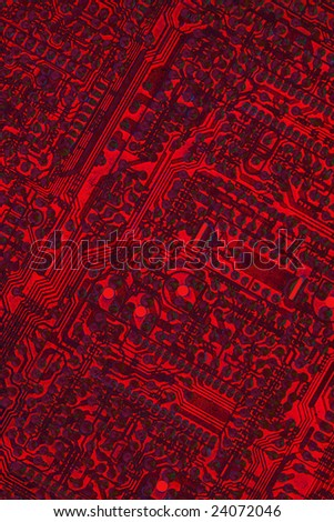 Close-up of microcircuit board. Old an dirty. Texture. Stylized. Red color. - stock photo