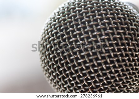 Close up of microphone grille in concert hall or conference room - stock photo