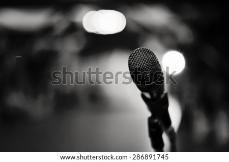 Close up of microphone in concert - stock photo
