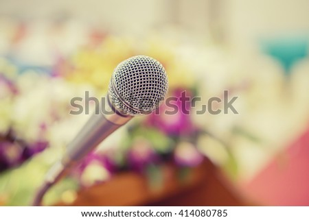 Close up of microphone in concert hall or conference room,conference hall or seminar room background,selective focus,vintage color,copy space - stock photo