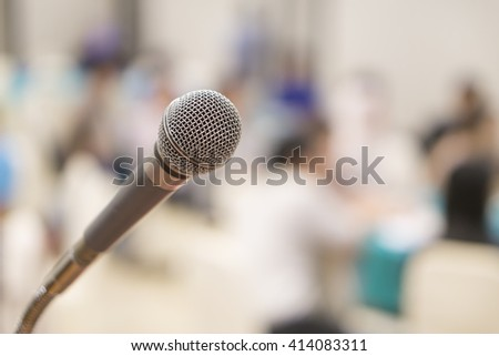 Close up of microphone in concert hall or conference room,conference hall or seminar room background,selective focus,vintage color,copy space