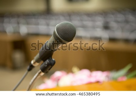 Close up of microphone in concert hall or conference room,low light