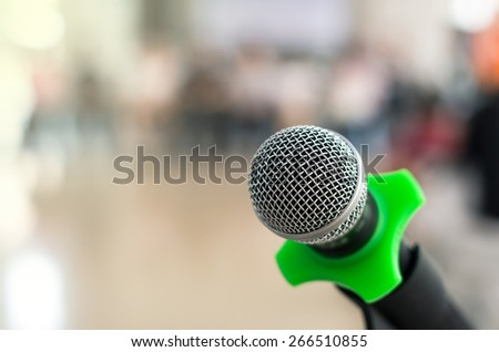 Close up of microphone in conference room on blurred background - stock photo