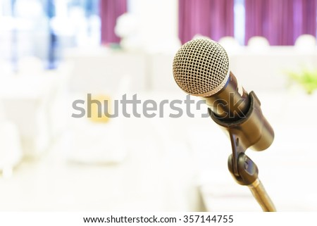 Close up of microphone in meeting room. - stock photo