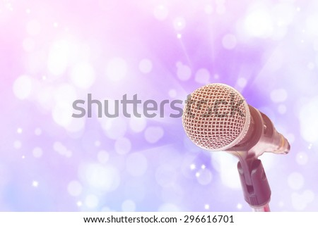 Close up of microphone on bokeh light background
