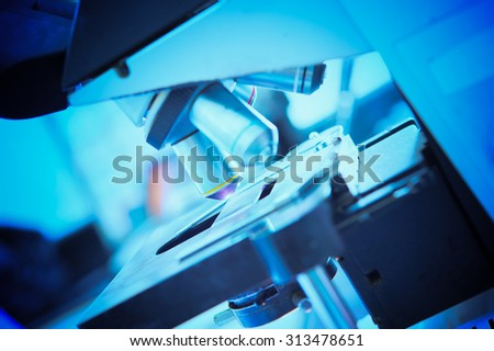 close up of microscope lens in laboratory hospital