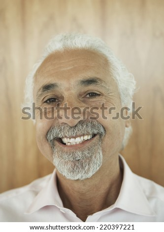 Close up of middle-aged man smiling - stock photo