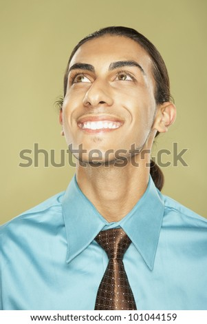 Close up of Middle Eastern businessman smiling