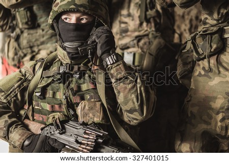 Close-up of military people on training ground - stock photo