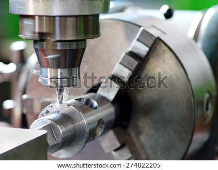 Close Up of Milling Machine in Operation with Smoking Bit, Demonstrating Precision in Manufacturing Mechanical Parts - stock photo