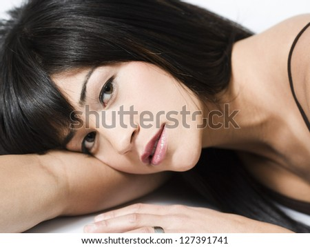 Close-up of mixed race woman lying