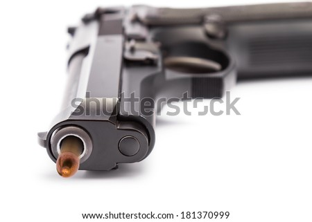 Close up of 9 mm. handgun focusing on the muzzle of gun with bullet head motion - stock photo