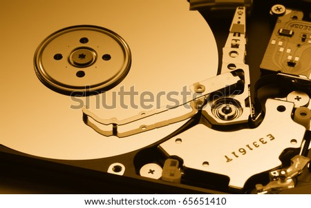 Close up of modern opened hard disk drive - stock photo