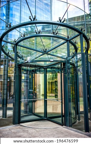 close-up of modern secured glass door at corporate business building. - stock photo